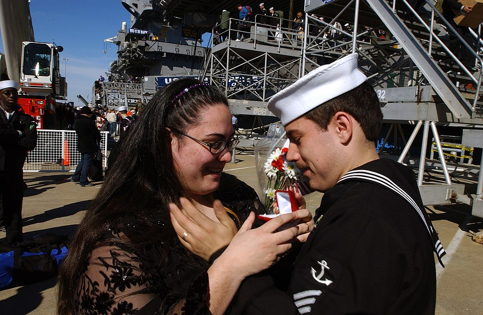 US Navy 040229-N-1464F-013 Seaman Stephen Aulds presents an engagement ring to his bride following his deployment aboard USS Enterprise (CVN 65)