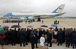 Crowds gather at Andrews AFB during 2004 to pay respect for former President Ronald Reagan, with a Boeing VC-25A of the 89th Airlift Wing in the background.