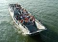 US Navy 040716-N-2651J-001 Landing Craft Utility (LCU) 1645 approaches the well deck aboard the amphibious assault ship USS Saipan (LHA 2).jpg