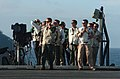 US Navy 040813-N-0841E-144 Landing Signal Officers (LSO) aboard the aircraft carrier USS John C. Stennis (CVN 74) evaluate each arrested landing.jpg