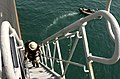 US Navy 041021-N-1348L-065 A Sailor assigned to the Visit, Board, Search and Seizure (VBSS) team from USS Preble (DDG 88), climbs the 80-foot accommodation ladder of a super oil tanker to conduct a Maritime Interception Operati.jpg