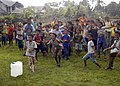 US Navy 050105-N-5376G-018 Indonesian children rush towards U.S. Navy helicopters USS Abraham Lincoln (CVN 72) as they unload purified water and relief supplies in a small village affected by the Tsunami a week ago.jpg