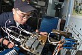 US Navy 050530-N-1332Y-141 Aviation Electronics Technician 3rd Class Regis Wu, from Brooklyn, N.Y., troubleshoots a circuit board aboard the conventionally-powered aircraft carrier USS Kitty Hawk (CV 63).jpg