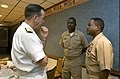 US Navy 050927-N-2383B-335 Chief of Naval Operations (CNO) Adm. Mike Mullen listens to Command Master Chief Renall Evans, right, and Master Chief Calvin Watson, both assigned to the Nimitz-class aircraft carrier USS Carl Vinson.jpg