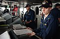 US Navy 060409-N-4776G-027 Lt. Cmdr. Karen Sray, watches a tracking monitor while standing the junior officer of the deck (JOOD) watch on the bridge of the Nimitz-class aircraft carrier USS Ronald Reagan (CVN 76).jpg