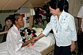 US Navy 060609-N-9076B-104 Philippine President Gloria Macapagal-Arroyo greets the grandmother of a 13 year old child who had surgery aboard U.S. Military Sealift Command (MSC) Hospital Ship USNS Mercy (T-AH 19).jpg