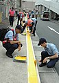 US Navy 060830-N-1332Y-045 Sailors assigned to the aircraft carrier USS Kitty Hawk (CV 63) apply fresh yellow paint to street curbs around Commander, Fleet Activities Yokosuka.jpg