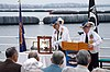 US Navy 070406-N-3234A-027 Members of the Submarine Veterans Association, retired Cmdr. Joe McGrievy, right, and retired Torpedoman's Mate 2nd Class C.J. Glassford toll a bell for each submarine lost during WWII at a Tolling of.jpg