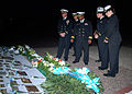 US Navy 070502-N-4021H-082 USS Pearl Harbor (LSD 52) Commanding Officer, Cmdr. Victor Cooper, and fellow Pearl Harbor officers pay homage to a memorial dedicated to the Argentinean ship ARA General Belgrano.jpg