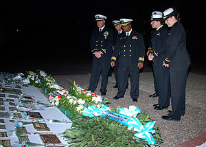 USS Phoenix (CL-46) - USS Pearl Harbor Commanding Officer and fellow officers pay homage to a memorial dedicated to the Argentinean ship ARA General Belgrano during a 25th anniversary remembrance service