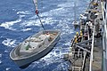 US Navy 070521-N-5067K-156 Members from deck department aboard Austin-class amphibious transport dock USS Juneau (LPD 10) crane a personnel launch (PL).jpg