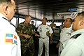 US Navy 070624-N-0989H-079 Capt. Douglas Wied, commander, Task Group 40.9, gives Valm Julio Cesar Ventura Bayonet, Valm Ivam Pena Castillo of the Dominican Republic Navy a tour of High Speed Vessel (HSV) 2 Swift.jpg