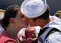 US Navy 070703-N-1688B-072 A new father aboard dock landing ship USS Oak Hill (LSD 51) greets his wife and baby after returning home to Naval Amphibious Base Little Creek.jpg