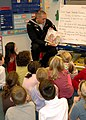 US Navy 071115-N-5690S-001 As part of the Reading is Fundamental program, Seaman Dustin Brzezniak, assigned to USS Constitution, reads a book to second-grade students at Cyris E. Dallin Elementary School.jpg