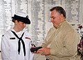 US Navy 071207-N-5476H-234 Tim Hodges presents his niece, Cryptologic Technician Interpretive (CTI) 2nd Class Bailey Sharbrough with the Purple Heart awarded to her great uncle Garris Hodges aboard the USS Arizona Memorial.jpg