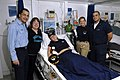 US Navy 071217-N-4776G-001 Laura Montero 14, from Albion, Ill., center, rests comfortably in the medical ward aboard the aircraft carrier USS Ronald Reagan (CVN 76) following an emergency appendectomy.jpg