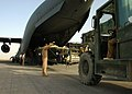 US Navy 080620-N-4500G-044 An Air Force crewman directs a forklift operator who carefully maneuvers a Naval Special Operations Craft-Riverine (SOC-R) out of an Air Force C-17 aircraft.jpg