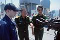 US Navy 080626-N-8138M-258 Lt. j.g. Ian Gray, left, Senior Colonel Pham Tan and Senior Col. Nguyen Van Toan of the Socialist Republic of Vietnam Army discuss a 50-caliber machine gun aboard the amphibious dockl landing ship USS.jpg