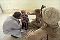US Navy 080723-M-0252M-072 Hospital Corpsman 2nd Class Matthew C. Blose takes an Iraqi boy's temperature at a clinic in Akashat.jpg