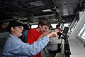 US Navy 080820-N-3610L-339 Mass Communication Specialist 2nd Class Courtney Dock explains the use of the gyro repeater, a part of the ship's navigation system, to a group of boy scouts on the bridge of the Nimitz-class aircraft.jpg
