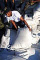 US Navy 080915-N-7955L-003 Operations Specialist Seaman Mike Watson, embarked aboard the amphibious assault ship USS Kearsarge (LHD 3), moves bags of rice during a humanitarian assistance mission in Haiti.jpg