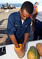US Navy 081103-N-6282K-177 Seaman Raphael Knight carves a pumpkin.jpg