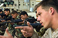US Navy 081227-A-6851O-081 Hospital Corpsman 3rd Class Wesley Gause, from Wisville, Texas, assigned to U.S. Marines 0731 Military Training Team, demonstrates how to properly aim an M-16 rifle.jpg