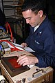 US Navy 090228-N-5402T-023 Aviation Electronics Technician 3rd Class Andrew Damin calibrates an air data test set.jpg