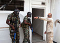 US Navy 090423-N-4143O-002 Sgt. Clifford Perry, an instructor with the Marine Corps Training and Advisory Group, guides members of the Jamaica Defense Force during a Southern Partnership Station urban raid exercise.jpg