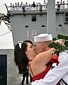 US Navy 090801-N-7027P-170 Electronics Technician 3rd Class Bryan Graves gives the first kiss to his wife as the amphibious transport dock ship USS New Orleans (LPD 18) returns from a seven-month deployment.jpg
