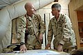 US Navy 090910-N-9818V-088 Cmdr. Bruce Nevel, commanding officer of Naval Mobile Construction Battalion (NMCB) 74, briefs Master Chief Petty Officer of the Navy (MCPON) Rick West.jpg