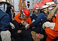 US Navy 091031-N-6692A-014 A medical team aboard the amphibious dock landing ship USS Tortuga (LSD 46) treats a simulated injury during a general quarters drill.jpg
