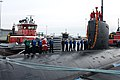 US Navy 091202-N-5339S-693 Santa Claus stands with Sailors aboard USS Miami (SSN 755).jpg