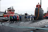 US Navy 091202-N-5339S-693 Santa Claus stands with Sailors aboard USS Miami (SSN 755)