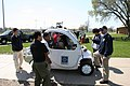 US Navy 100429-N-9876C-010 Mark Schultz, environmental director for Naval Facilities Engineering Command (NAVFAC) Midwest, explains to students at North Chicago Community High School about electric vehicles.jpg