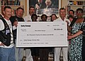 US Navy 100709-N-8361C-001 Rear Adm. Alton Stocks accepts a check for $6,026.42 on behalf of The Fisher House.jpg