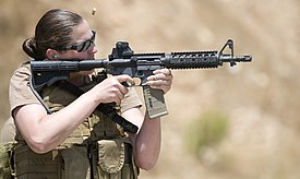 US Navy 100714-N-4965F-174 Chief Mass Communication Specialist Paula Ludwick, assigned to Fleet Combat Camera Group Pacific, shoots at a target during a Navy Rifle Qualification Course.jpg