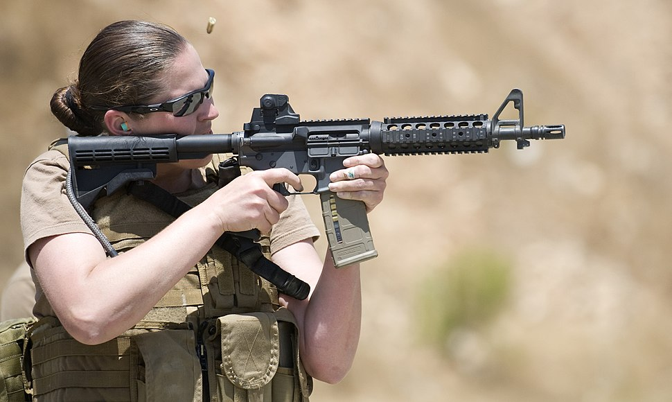 US Navy 100714-N-4965F-174 Chief Mass Communication Specialist Paula Ludwick, assigned to Fleet Combat Camera Group Pacific, shoots at a target during a Navy Rifle Qualification Course