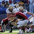 US Navy 100906-N-7647G-004 Navy full back Vince Murray rushes for a gain against Maryland.jpg