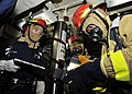 US Navy 101215-N-6499D-052 ulinary Specialist 2nd Class Korhy Flanary, left, Culinary Specialist Seaman Recruit Paul Osis, and Damage Controlman 3r.jpg