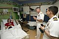 US Navy 110525-N-HZ247-149 Vice Chief of Information Rear Adm. Kenneth Braithwaite and Cmdr. Gus Gutierrez talk to a patient at the AI Dupont Childr.jpg