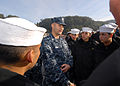 US Navy 110613-N-ZI300-118 Electronics Technician 1st Class Fred Hannah discusses U.S. Navy uniforms with a group of Chilean navy recruits, called.jpg