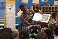 US Navy 110721-N-GZ984-119 First lady Michelle Obama reads to 5 and 6-year-olds at the Naval Air Station Oceana Child and Youth Programs summer cam.jpg