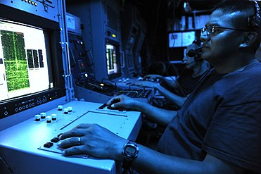 US Navy 110721-N-WL435-007 Mineman 2nd Class Ray Mares operates the classified console aboard USS Gladiator (MCM 11).jpg