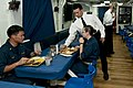 US Navy 111124-N-ER662-060 Senior Chief Gas Turbine Systems Electrical Cliff Calvales serves beverages to sailors during Thanksgiving dinner aboard.jpg