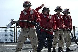 US Navy 120208-N-KS651-126 Sailors participate in a flight deck fire fighting drill aboard the amphibious dock landing ship USS Pearl Harbor (LSD 5.jpg