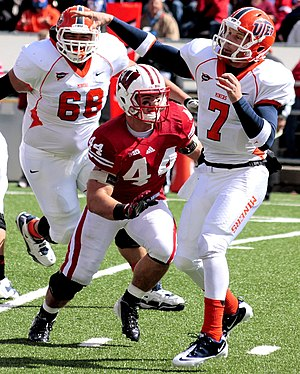 Chris Borland - UTEP QB Nick Lamaison throws an incomplete pass under pressure from Borland