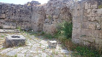 Ugarit - Remains of the ancient city, some walls and what appears to be a small well.