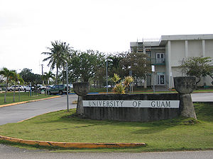 Latte stone - The sign for the University of Guam is flanked by decorative latte stones