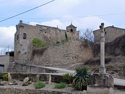 Vallfogona's castle and creu de terme (boundary cross)